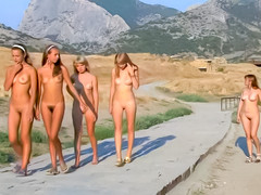 Teen naturist babes go for a walk in the mountains
