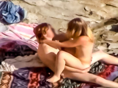 Voyeur hardcore scene with beach couple