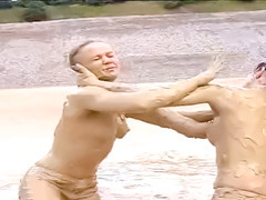 Mud wrestling young ladies with perky tits