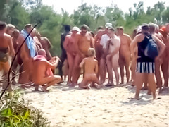 Group of guys masturbates onto amateur nudist woman at Cap d'Agde