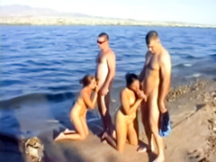 Beach blowjobs in foursome fuck video clip