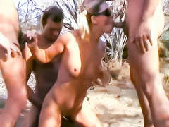 Pigtail girl gangbanged outdoors in the sand